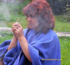 Andean Curandera Doris Rivera Lenz with coca leaf at Ofrenda ceremony